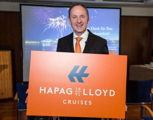 Karl J. Pojer, Vorsitzender der Geschäftsführung, mit dem neuen Hapag-Lloyd Cruises Logo / © Hapag Lloyd Cruises
